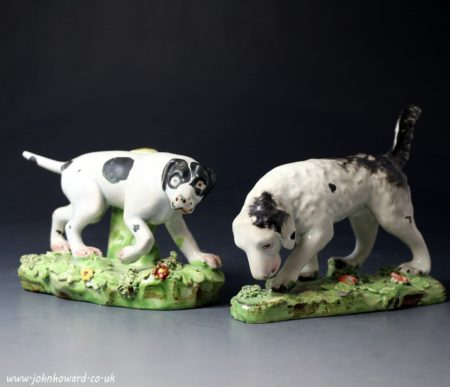 Antique Staffordshire pearlware pottery pair of figures of pointer and setter sporting dogs