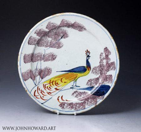 English delftware pottery farmyard plate with a peacock, Bristol delftworks  18th century