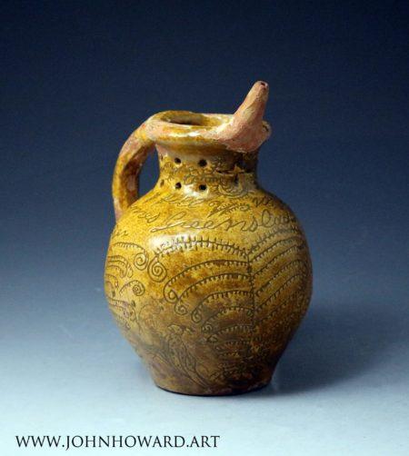 Donyatt Pottery Somerset slipware earthenware puzzle jug  named and dated.