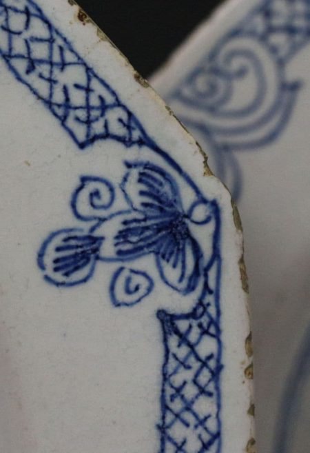 English delftware blue and white octaganol shaped plate with a putti. 18th century London