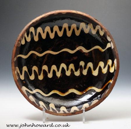 An earthenware slipware circular dish 18th century Midlands or Northern England