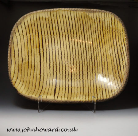 A large size English earthenware combed decorated slipware baking dish or loaf dish circa 1800.