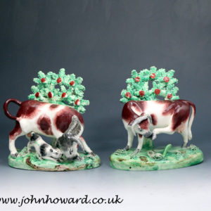Staffordshire pottery pearlware bocage figures of a cow and bull early 19th century